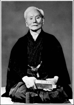 "The father of modern karate, Gischen Funakoshi, sitting in ""seiza."""